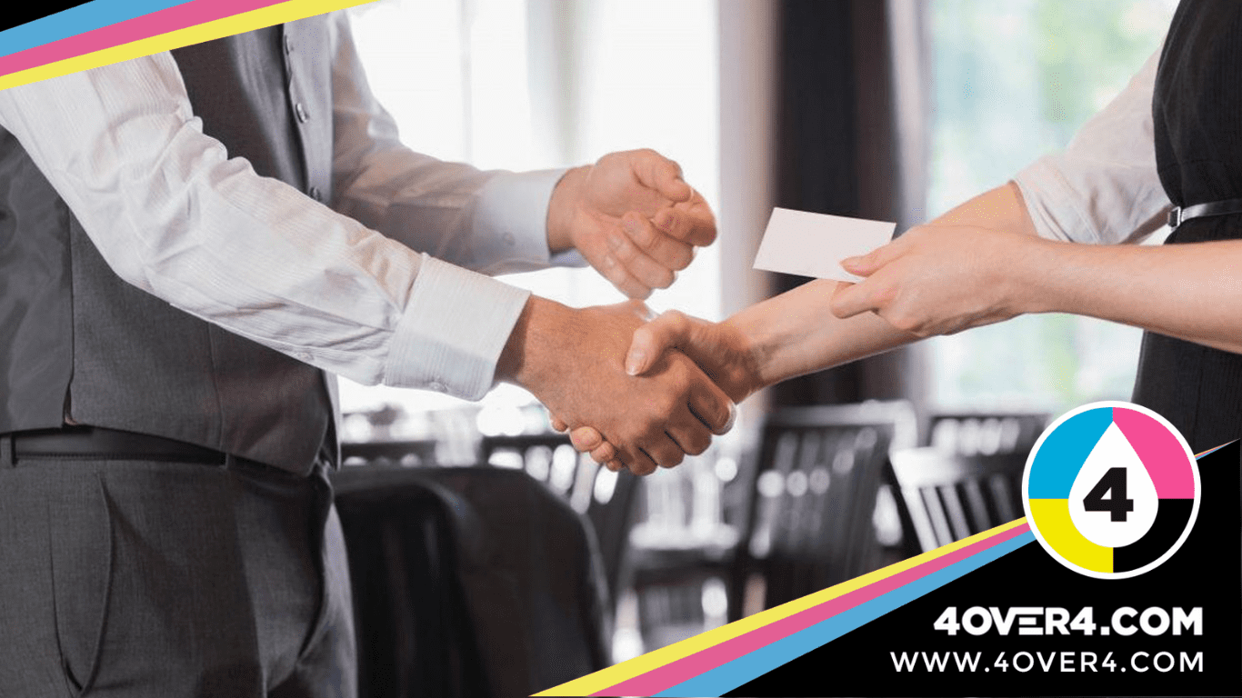 Shaking hands while exchanging visiting card