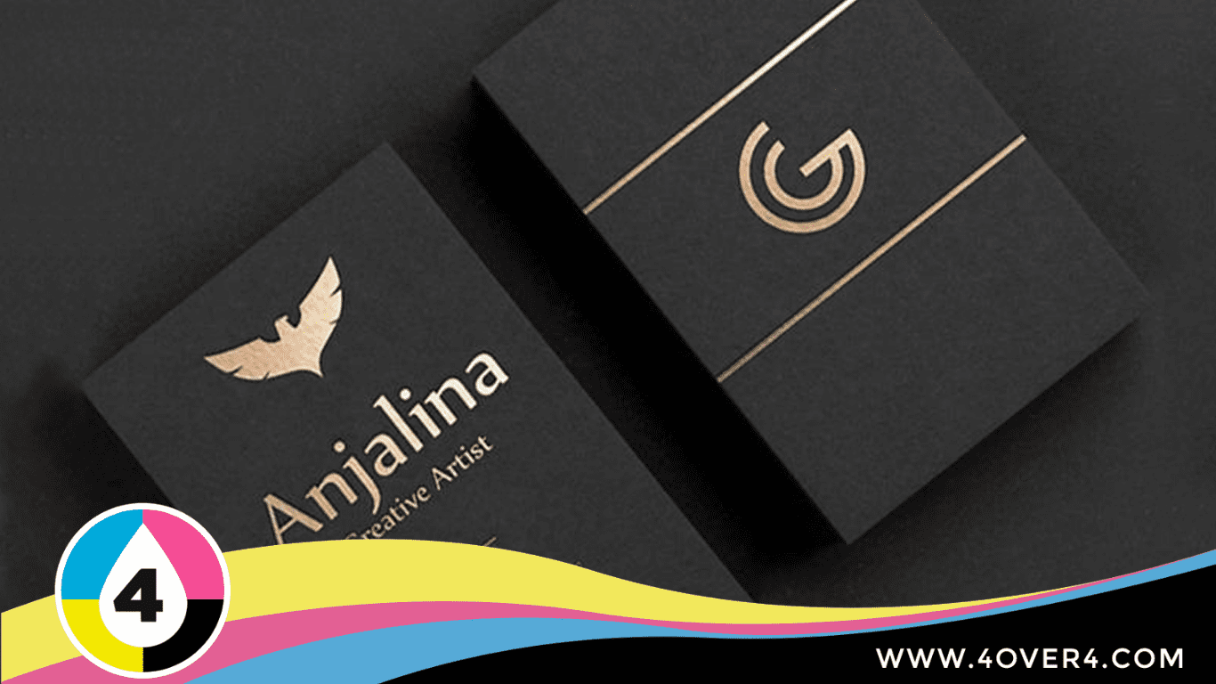 Black business card with golden logo at the back