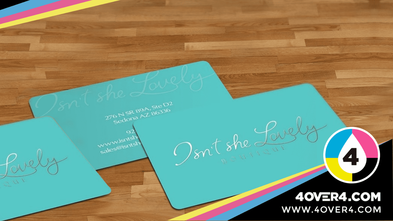 Turquoise business cards with silver foil printing